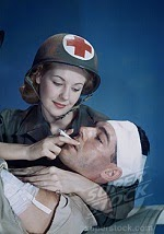 spinalconcussion Nurse assisting an injured army soldier smoking a cigarette
